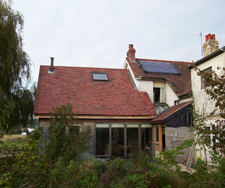 Solar water heating panels on farmhouse roof
